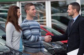 Couple discussing auto insurance with the agent