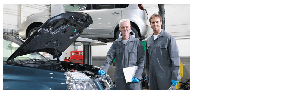Two male mechanic work at repair service station
