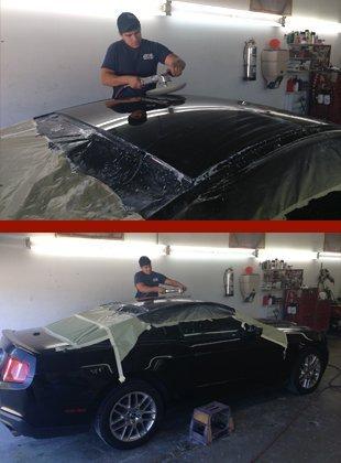 Repairmen fixing the car damages