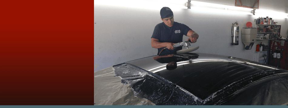 Repairman installing a new car bumper