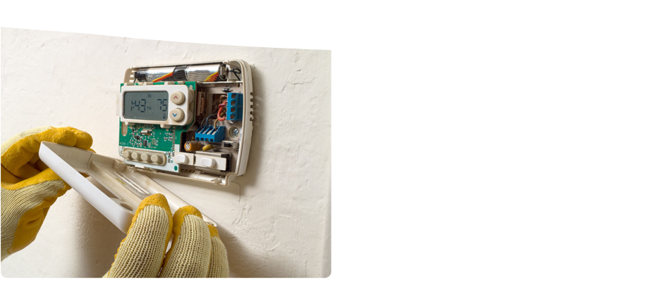 A man holding the cover of a temperature control device for repair service