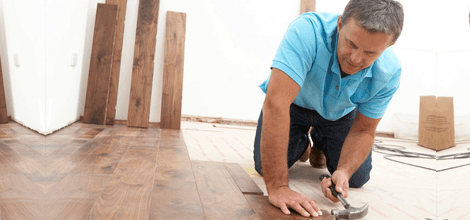 contractor installing wood flooring