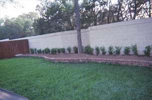 Landscape paver with white brick wall