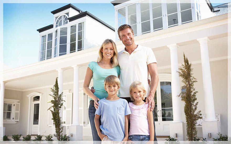 Happy family infront of beautiful house