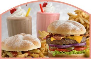 Cheeseburgers with milkshakes and fries
