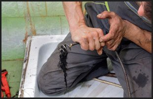Plumber cleaning sewer
