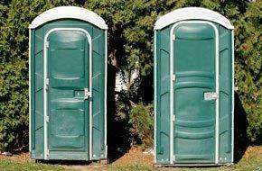 Two green portable toilets