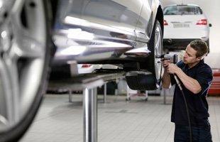Mechanic tightening a tire