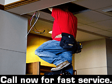 Electrician - Oak Ridge, LA - George Word Electric - electrician fixing the wiring - Call now for fast service.