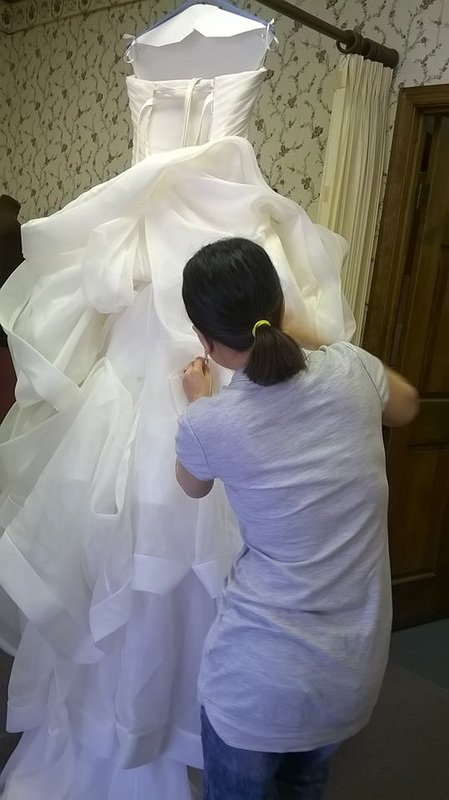 Dressmaking of a wedding gown
