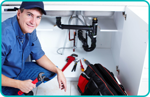 A plumber is holding a wrench
