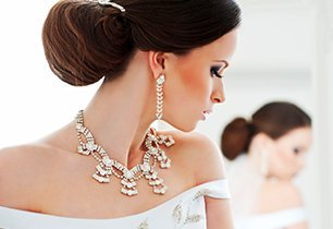 Bride wearing luxurious earrings and necklace