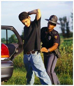 Cop arresting a guy
