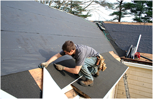 Roofer doing roof repair