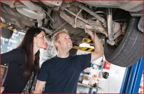 Mechanic showing the damage to the car owner