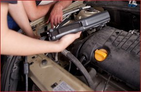 Mechanic diagnosing the car radiator and ac