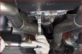 Mechanic fixing the transmission