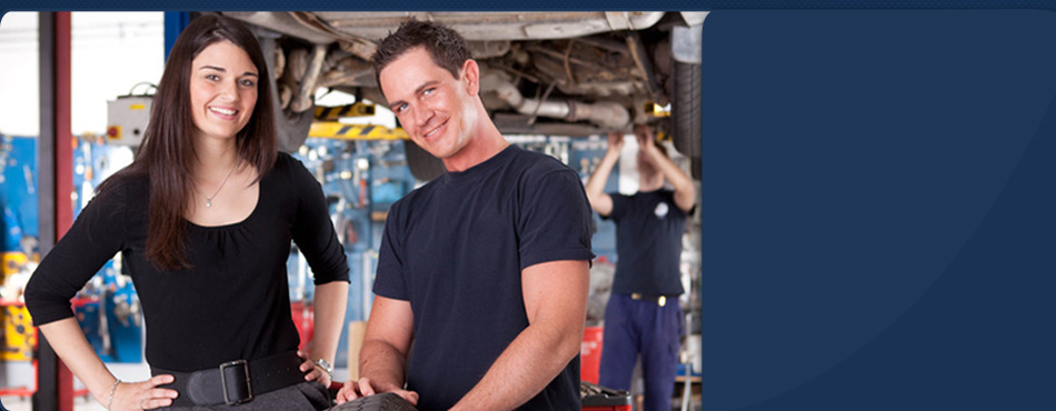 Mechanic man and woman smiling