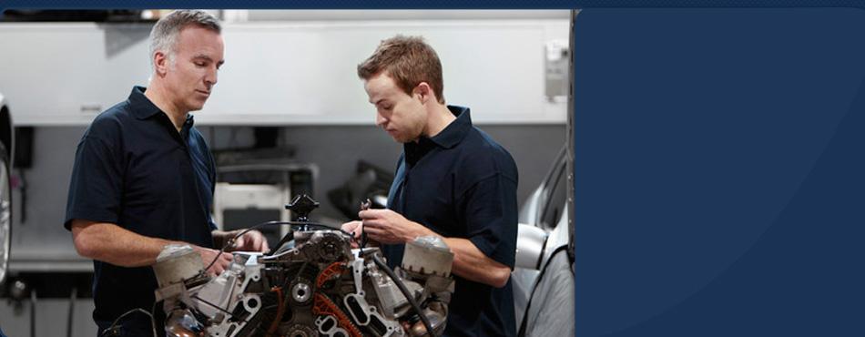 Two mechanic repairing car engine