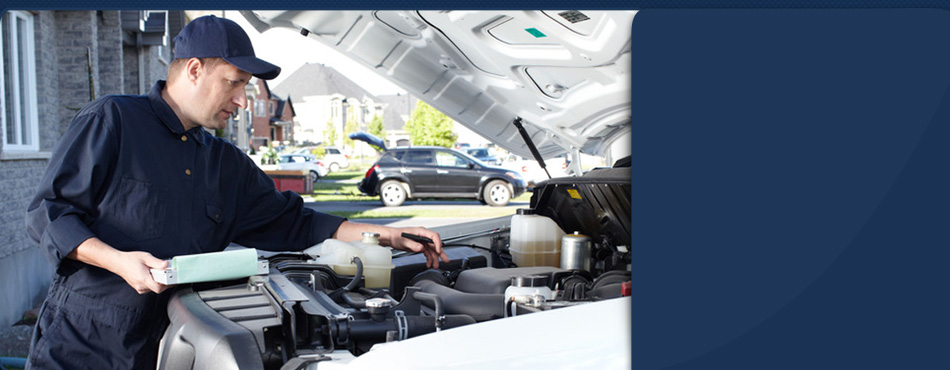 Mechanic performing engine diagnostic
