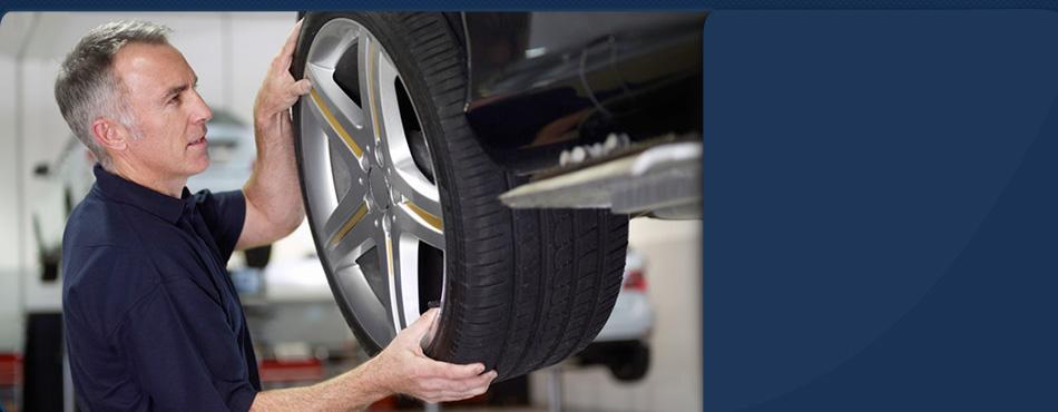 Mechanic installing tire