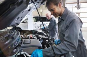 Mechanic in gray jumpsuit