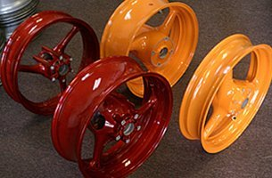 Dark candy red and orange mist on cast motorcycle wheels