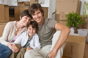 A happy family with boxes on the background
