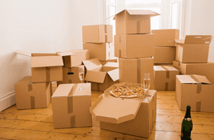 Cardboard boxes with pizza and drink