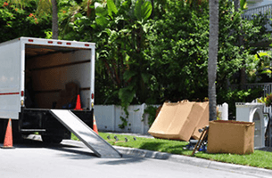 A moving van on street with ramp
