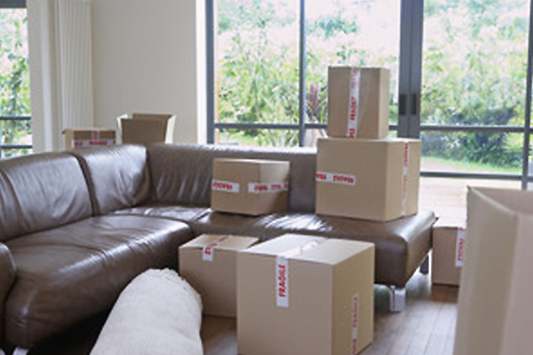 View Of Packed Cardboard Boxes In Living Room Of A New Home ...