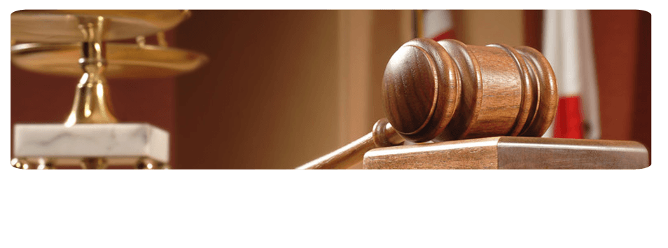 wooden gavel and justice statues