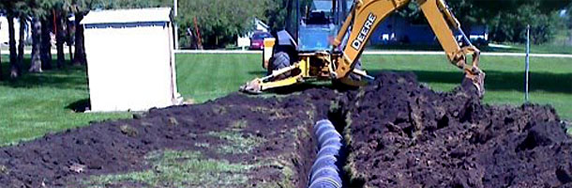 House sewer line assembled on a dig ground area