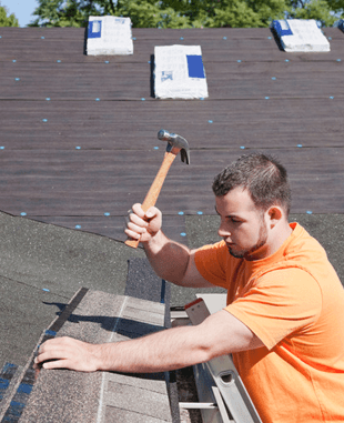 A man fixing the roof