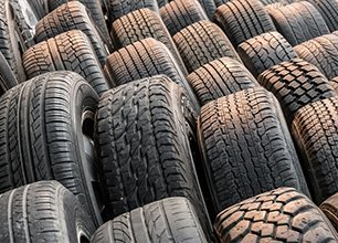 Stacks of old used tires for sale