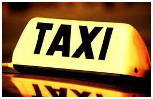 Working man hailing a taxi