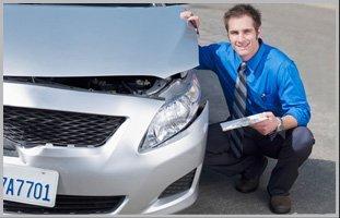 Man beside a damage car