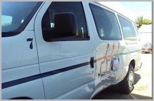 Damaged white van