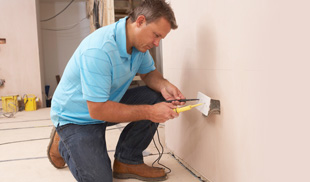 Electrician installing an electric outlet