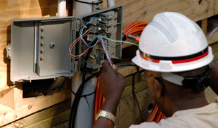 Electrician rewiring an electric box