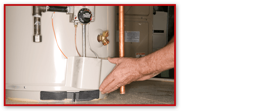 Man installing water heater system