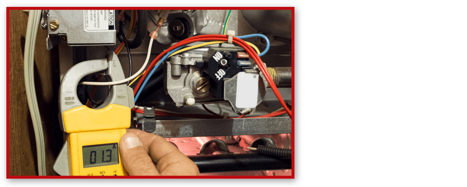 Plumber checking water heater wiring system