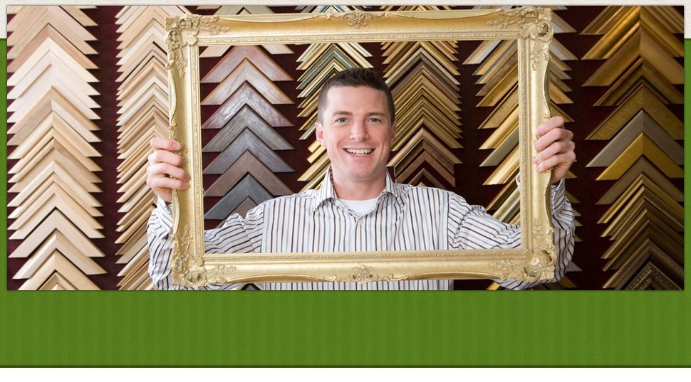 Man holding a picture frame