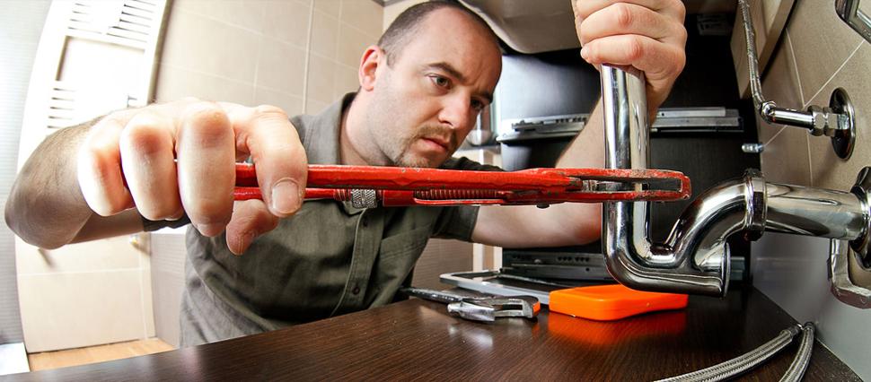 Man installing kitchen sink