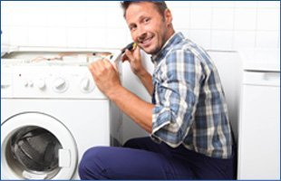 Happy technician repairing the dryer