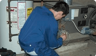 Repairman fixing the water heater