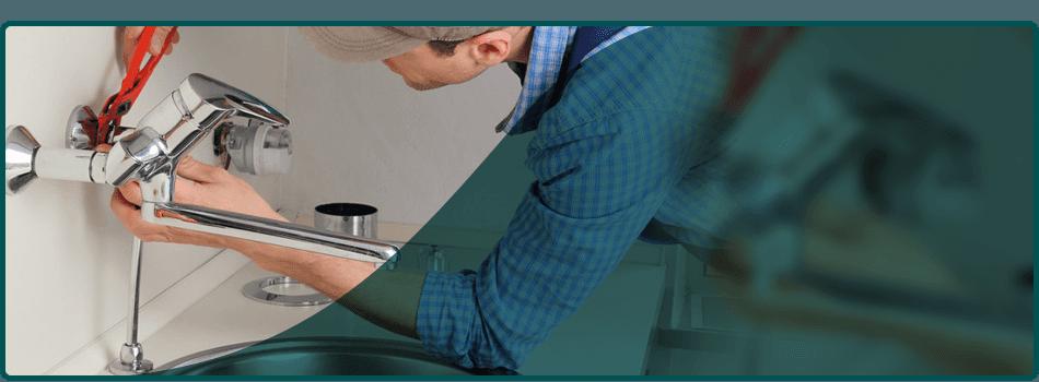 Repairman installing new faucet