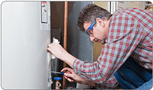 Repairman fixing hot water heater