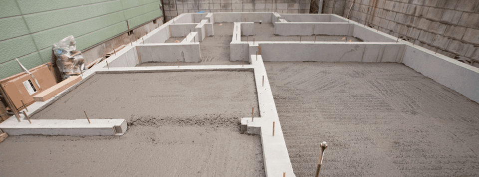 Footers filled with flatwork concrete
