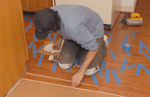 Man Installing Hardwood Floor